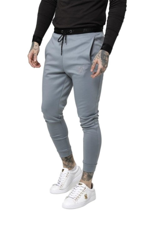 Pantalon de Chandal SikSilk Agility Gris